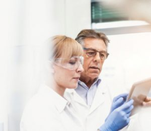 People in lab documenting process