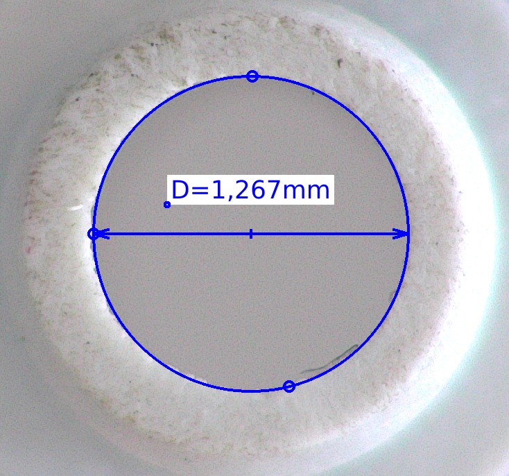 Measurement performed on plastic object by software app from digital microscope with built in computer